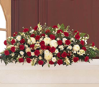 Hope and Honor Full Casket Spray by Rich Mar Florist