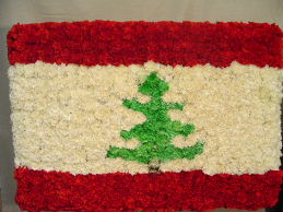 Country Flag Standing Spray by Rich Mar Florist